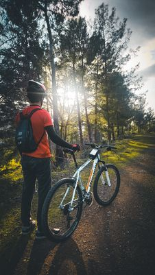 Free Photo Of Man Wearing Red Shirt Holding White Mountain Bike Royalty Free Stock Photography - 109924727