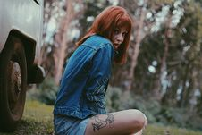 Free Photo Of A Woman In Blue Denim Jacket Sitting Near White Car Stock Images - 109924894