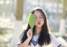 Free Woman Holding Green Leaf With Lips Kissing And Closing Eyes Royalty Free Stock Image - 109924906