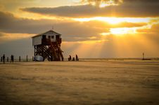 Free White Lifeguard House On Beach Taken Under White Clouds And Orange Sky Royalty Free Stock Image - 109925046