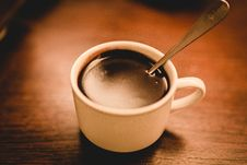 Free White Ceramic Espresso Cup Filled With Coffee On Brown Wooden Surface Royalty Free Stock Photography - 109925087