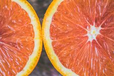 Free Two Sliced Citrus Fruits Royalty Free Stock Images - 109925099