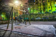 Free Playground Surrounded With Buildings And Cars Stock Images - 109925284