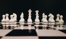 Free White Chess Piece On Top Of Chess Board Stock Photography - 109925302