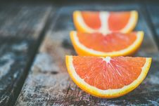 Free Three Sliced Orange Fruits Stock Photography - 109925332
