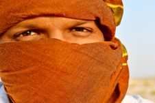 Free Man Cover Face Using Scarf Stock Image - 109925371