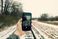 Free Person Holding Iphone Taking Photo Of Train Rails Royalty Free Stock Photography - 109925377
