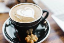 Free Black Ceramic Cup With Brown Liquid With Heart-shape On Black Ceramic Saucer Stock Image - 109925381