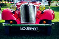 Free Classic Red Car On Green Grass Stock Images - 109925464