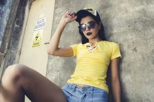 Free Woman Wearing Yellow Lace-up Neckline T-shirt Royalty Free Stock Photography - 109925467