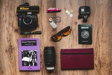 Free Black Nikon Dslr Camera, Gopro Hero Session, And Black Framed Sunglasses Royalty Free Stock Photos - 109925558