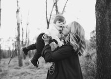 Free Grayscale Photo Of Woman Kissing Toddler On Cheek Stock Images - 109925584