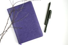 Free Purple Leather Notebook, Black Pen, And Brown Branches Royalty Free Stock Images - 109925609