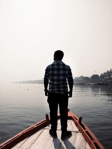 Free Man Standing On Wooden Boat Royalty Free Stock Image - 109925716