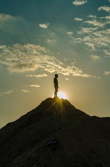 Free Silhouette Of A Man Standing On A Mountain Stock Image - 109925751
