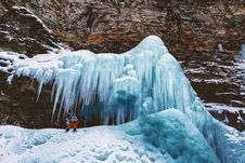 Free Person Sits On Mountain With Icicles Royalty Free Stock Photos - 109925878