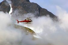 Free Red Helicopter On Top Of Foggy Mountain Stock Images - 109926054