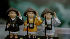 Free Three Children In Brown Traditional Hats Toy Miniatures Stock Images - 109926064