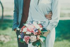 Free Man And Woman Standing On Grass Field Stock Image - 109926231