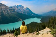 Free Person Sitting On Rocky Mountain Near Body Of Water Stock Images - 109926314