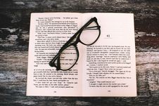 Free Photography Of Eyeglasses On Top Of Book Royalty Free Stock Photo - 109926325
