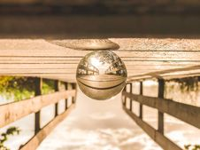 Free Macro Photography Of Round Glass Ball On Top Of Brown Wooden Dock Stock Photos - 109926363