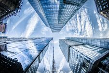 Free Low-angle Photo Of Four High-rise Curtain Wall Buildings Under White Clouds And Blue Sky Royalty Free Stock Photos - 109926378
