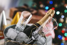 Free Selective Focus Photography Of Brown Labeled Bottle And Two Clear Glass Champagne Flutes Royalty Free Stock Photo - 109926485