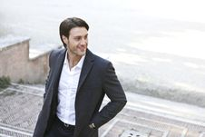 Free Man In White Dress Shirt And Black Blazer Standing Outside Building Royalty Free Stock Photography - 109926637