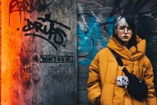 Free Woman In Yellow Coat With Black Crossbody Bag Closing Her Eyes Stock Images - 109926744