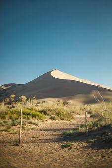 Free Green Grass Across Desert Under Blue Sunny Sky Royalty Free Stock Photos - 109926798