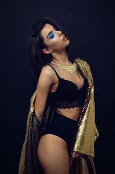 Free Woman Wearing Black Brassiere And Panty With Sequinned Gold-colored Coat Robe Stock Photo - 109926840