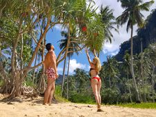 Free Woman Wearing Black Bikini Top And Red Bottom Beside Man Wearing White And Red Floral Shorts Royalty Free Stock Photography - 109926907