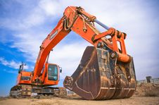 Free Red Excavator Under The Blue Sky Stock Images - 109926934