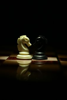 Free Two White And Black Chess Knights Facing Each Other On Chess Board Stock Photo - 109926950