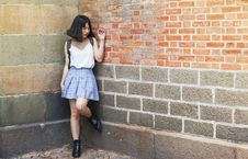 Free Woman Beside Brick And Cinder Wall Royalty Free Stock Photography - 109927027