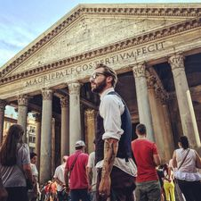 Free Man In Blue Waistcoat And White Dress Shirt Standing Near Magrippa Lf Costertivm Fecit Temple Behind Crowd Of People Stock Images - 109927124