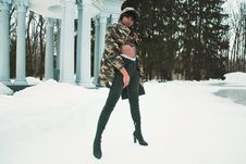 Free Woman Wearing Camouflage Jacket Standing On Snow Royalty Free Stock Photography - 109927207