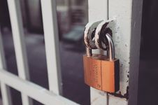 Free Closeup Photography Of White Gate With Brass-colored Padlock Stock Photo - 109927210