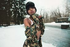 Free Woman Wearing Camouflage Shirt Covered By Snow Stock Images - 109927234
