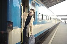Free Man Wearing Beige Overcoat Inside Train Stock Photos - 109927253