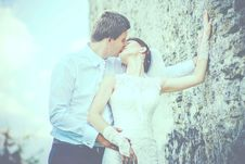 Free Man Kissing Woman Wearing Sleeveless Wedding Gown Stock Photography - 109927432
