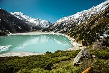 Free Blue Lake Surrounded By White Snowcapped Mountain Stock Photo - 109927520