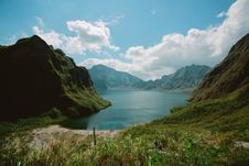 Free Photography Of Mountains Near Body Of Water Stock Photos - 109927533