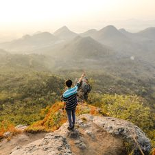 Free Photo Of Man Standing On Rock Mountain Pointing Out Mountain Stock Images - 109927534