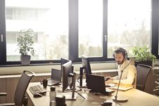 Free Man With Headphones Facing Computer Monitor Stock Photography - 109927542