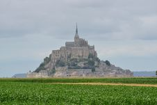 Free Mont Saint-michel Under White Clouds And Blue Sky Stock Image - 109927611
