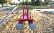 Free Red And Gray Seesaw In The Playground Royalty Free Stock Images - 109927659