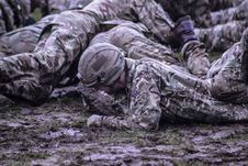 Free Group Of Soldiers Crawling On Mud Royalty Free Stock Photography - 109927687