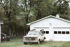 Free Gray Chevrolet Car Parked Near White Shed Stock Photography - 109927782